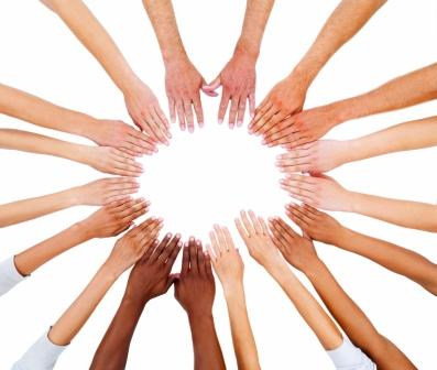 Peoples hands in a circle against white background